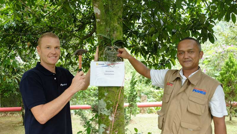 Ceremonial orchid planting with Indonesia Power