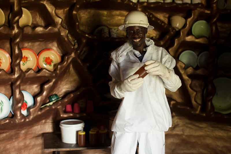 A beekeeper in Hurungwe district bottling honey