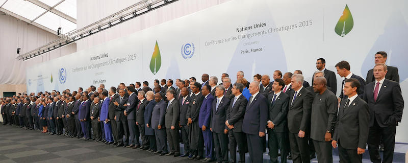 International leaders stand together at the gathering of COP21 in 2015. Presidencia de la Republica Mexicana via Flickr