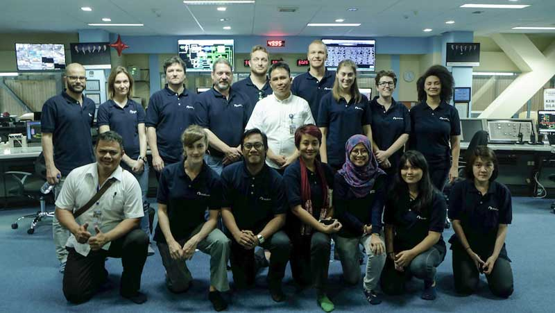 The South Pole marketing team with Indonesia Power employees inside the central control room